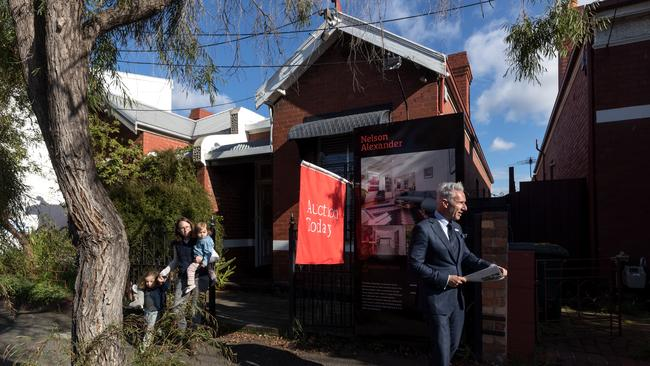 Nelson Alexander auctioneer Arch Staver working the 137 Gold St, Clifton Hill. Picture: Mark Dadswell