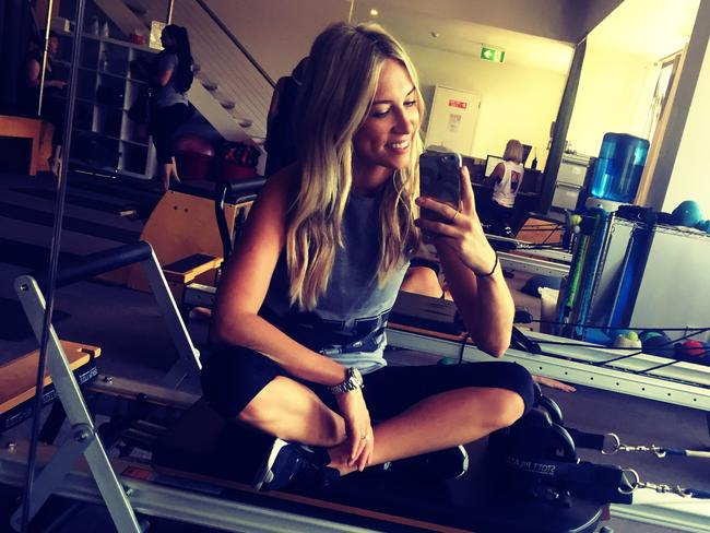 Phoebe loving life in the reformer pilates studio. Picture: Phoebe Burgess.