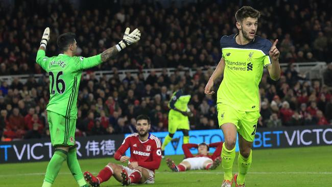 Liverpool's English midfielder Adam Lallana (R) celebrates scoring.