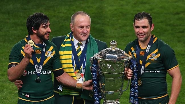 Johnathan Thurston, Tim Sheens and Cameron Smith celebrate with the Rugby League World Cup after victory over New Zealand in ...