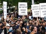 <p>Supporters of Islamic political movement Hizb ut-Tahrir protest outside the US Embassy in London. Picture: AP</p>