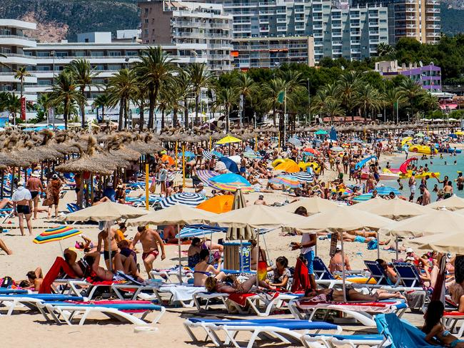 Tourists sunbathe at Magaluf beach, Majorca. Magaluf is one of the Britain's favourite holiday destinations popular with sun, beach and clubbers alike. Photo: David Ramos/Getty Images