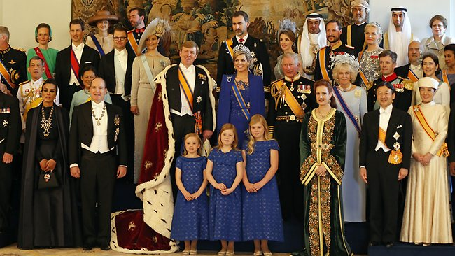 Dutch King Willem-Alexander and his wife Queen Maxima pose for a group photo with their Royal guests inside the Royal Palace in Amsterdam, The Netherlands, Tuesday April 30, 2013. Around a million people are expected to descend on the Dutch capital for a huge street party to celebrate the first new Dutch monarch in 33 years. (AP Photo/Bart Maat, pool)