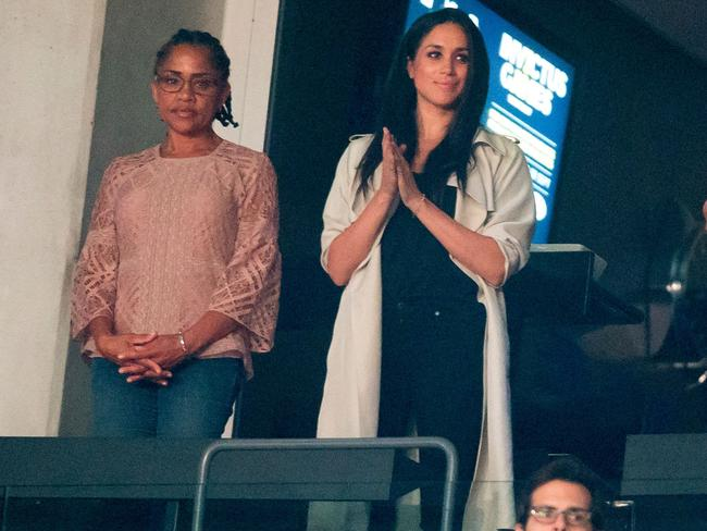 Meghan Markle (C) and her mother Doria Radlan (L) watch the closing ceremonies for the Invictus Games in Toronto, Ontario, September 30, 2017. Picture: AFP.