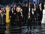 Prior to learning of a presentation error, 'La La Land' producers Marc Platt (speaking at microphone), Jordan Horowitz and Fred Berger accept the Best Picture award for 'La La Land' (later awarded to actual Best Picture winner 'Moonlight') onstage during the 89th Annual Academy Awards. Picture: Getty