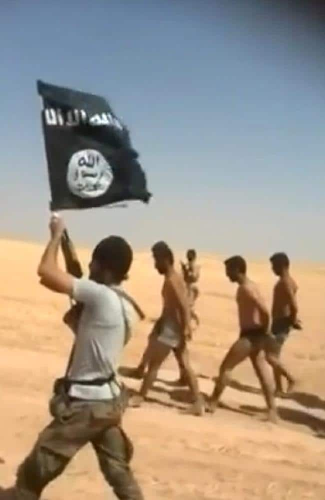 Alleged execution ... young men in underwear being marched barefoot along a desert road by Islamic State militants at an undisclosed location in Syria's Raqa Province. Picture: AFP