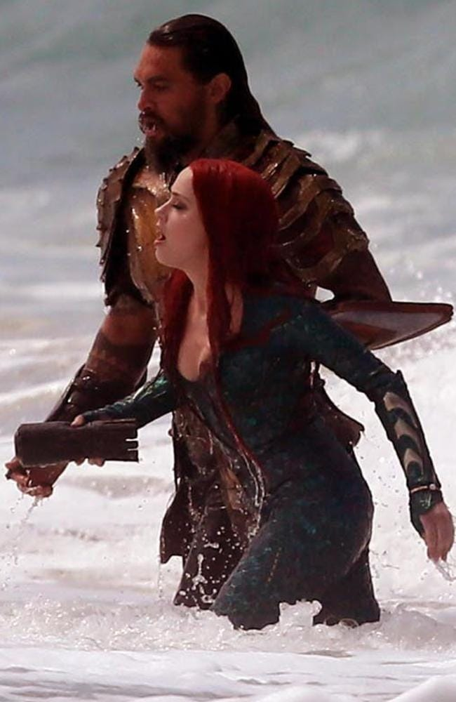 Jason Momoa and Amber Heard in the surf at Currumbin Alley today for Aquaman reshoots. Picture: Andrew Carlile/MEGA