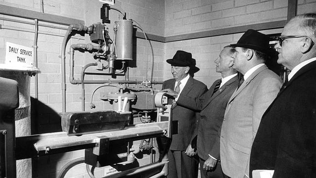 Fluoride is first added to water at the Kangaroo Creek reservoir in 1971, with former SA politician Des Corcoran, second from right, watching. Black hats optional.