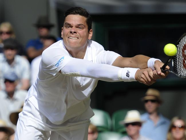 Canada's Milos Raonic returns to Switzerland's Roger Federer.