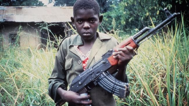 Born to fight ... a child soldier of Uganda in 1996. Picture: World Vision.