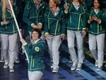 Australian flagbearer Anna Meares leads the Australians into the stadium at the Glasgow Opening Ceremony at Celtic Park. Pics Adam Head