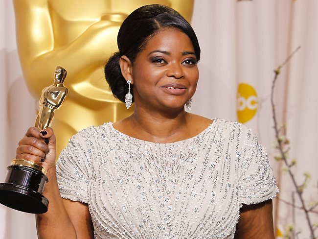 """Octavia Spencer poses with her award for best supporting actress for """"The Help"""". Picture: AP"""