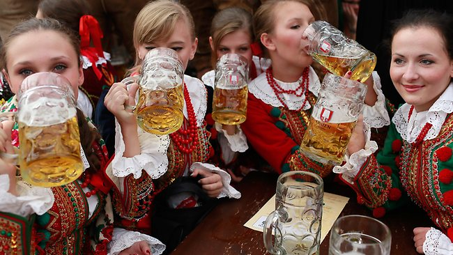 Polish girls, dressed with traditional Polish costume enjoy drinking beer after participating in the opening parade during day 2 of Oktoberfest beer festival in Munich, Germany. Picture: Getty