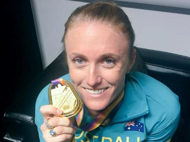 Sally Pearson with her gold medal after she won the 100m hurdles at the World Athletics Championships in London.