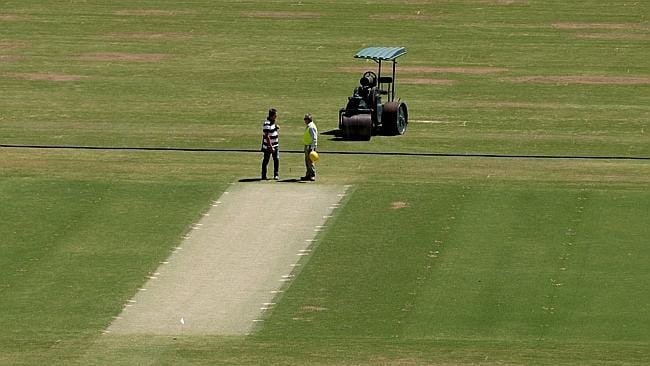 Ground staff working on the Adelaide Oval pitch. Picture: Mike Burton.