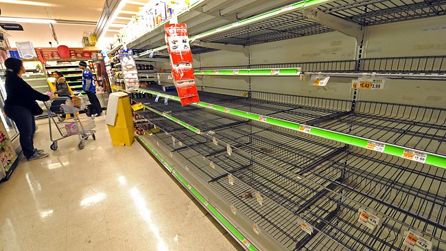 A shopper finds the bread shelves empty at a Supermarket in Manhattan Sunday. Picture: AP
