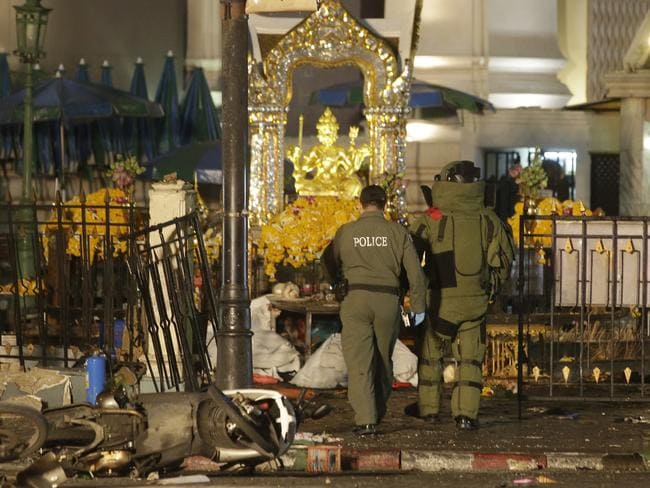 Tourist attraction ... Explosive Ordnance Disposal officers enter the Erawan Shrine after the blast. Picture: AP Photo/Sackchai Lalit