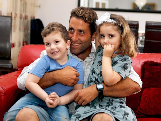 Noah and Lahela al-Amin pose for a picture with their father Ali Elamine. Picture: Supplied