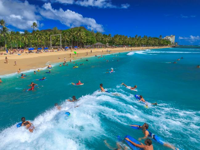 ESCAPE: JUNE 25. Christmas holidays cover story, Jason Dutton-Smith. Body boarding is a popular water sport in Waikiki area. One of best places to board is near the Waikiki Pier at Queens Surf Beach, a section of Waikiki Beach. Picture: istock