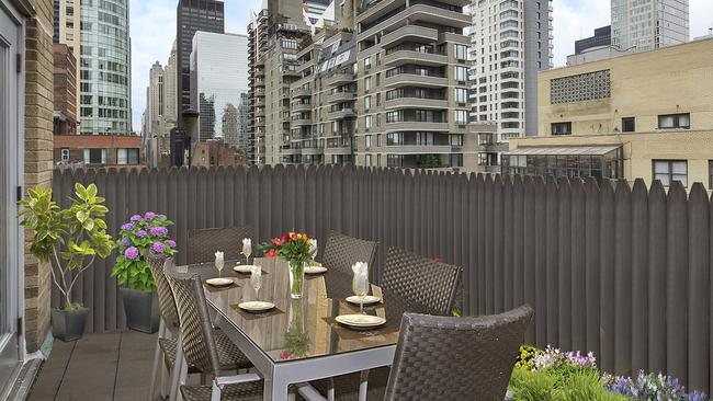 It has a deck which overlooks the city. Picture: Douglas Elliman Real Estate