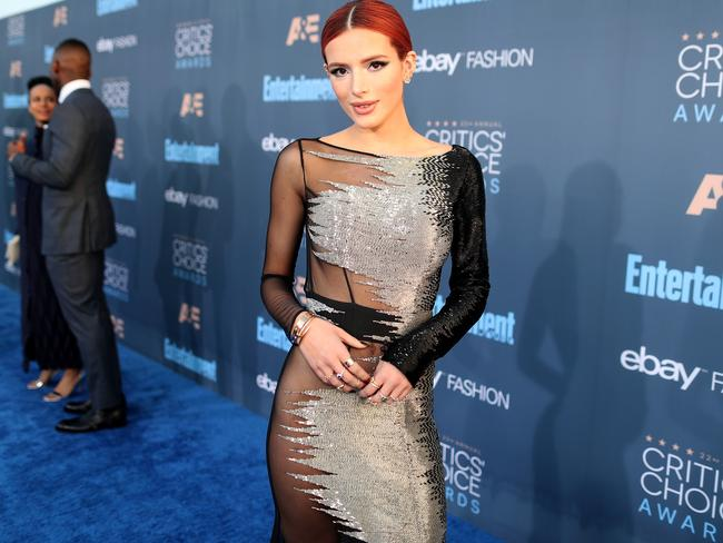 Bella keeps the hair and makeup simple on the blue carpet at the Critics' Choice Awards.