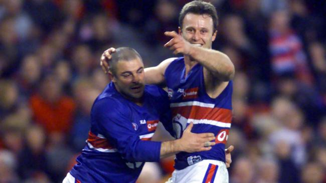 Chris Grant celebrates his famous match-winning goal with Steven Kolyniuk. Picture: Michael Dodge