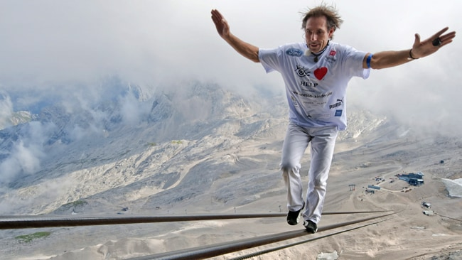 He will attempt to scale seven summits in seven days, with no safety harness. Picture: AFP
