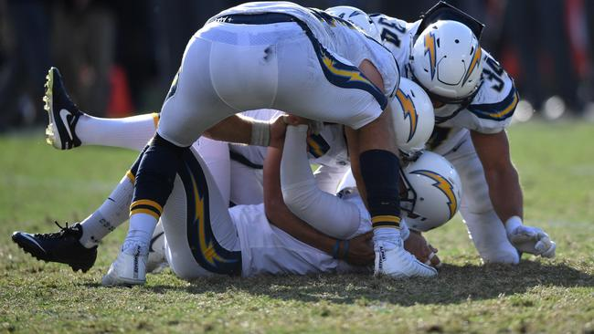 Chargers players celebrate with Nick Novak after he kicked the game winning field goal.