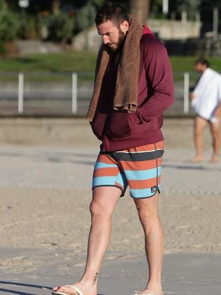 Darius Boyd heads to the beach for a morning swim at Brighton in Sydney as part of the Queensland Origin setup