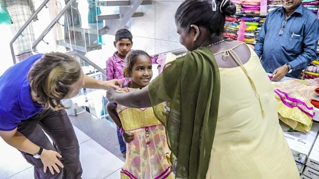 We took the whole family shopping to buy essentials like clothes, shoes, school supplies and tools for the father to help him earn a better wage. And Divya just had to have this beautiful dress. Picture: Chris Bray