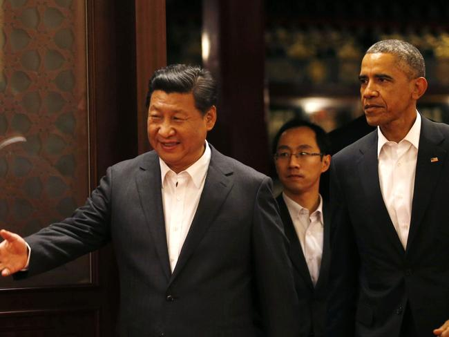Who's leading who? China's president, Xi Jinping, with US president Barack Obama.
