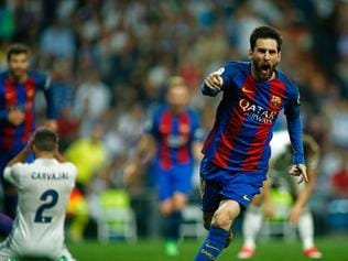 TOPSHOT - Barcelona's Argentinian forward Lionel Messi celebrates after scoring during the Spanish league Clasico football match Real Madrid CF vs FC Barcelona at the Santiago Bernabeu stadium in Madrid on April 23, 2017. / AFP PHOTO / OSCAR DEL POZO