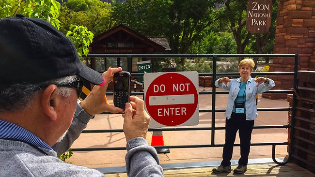 Donna Rice makes a thumbs down for a photo by her husband Barry after they traveled from Chicago to Zion National Park, which was closed due to the government shutdown. Picture: AP/The Salt Lade Tribune, Trent Nelson