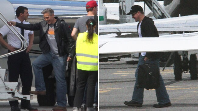 High-fliers: George Clooney and Matt Damon board a private jet out of Lugano Airport in Switzerland. Picture: Splash
