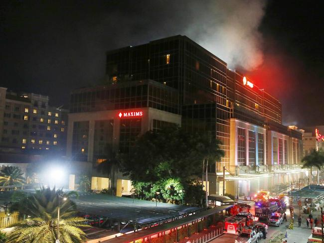 Smoke rises from the Resorts World Manila complex. Picture: AP