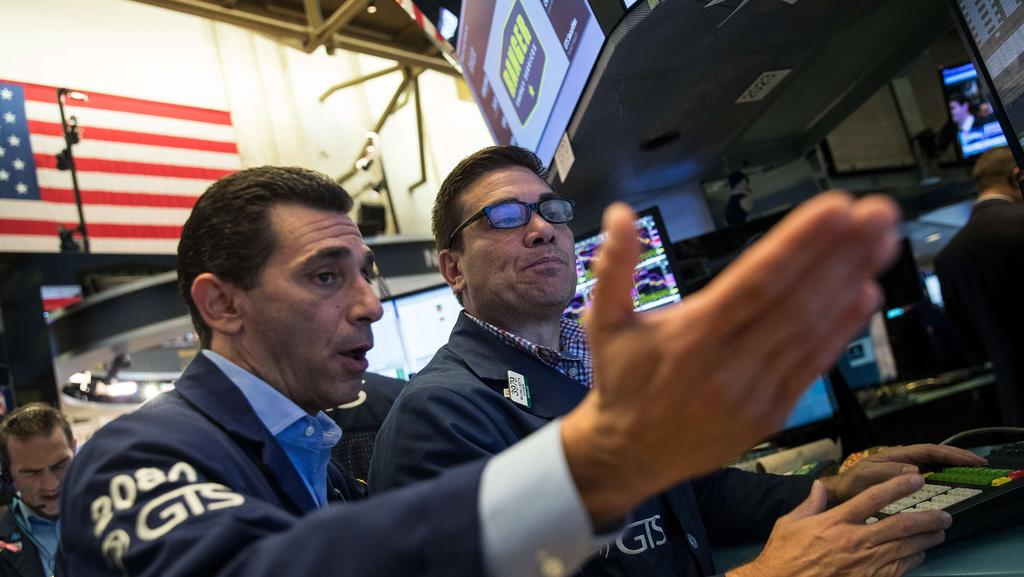 Traders and financial professionals work the floor of the New York Stock Exchange (NYSE) ahead of the opening bell, 11 August 2017 in New York City. Picture: Drew Angerer/Getty Images/AFP