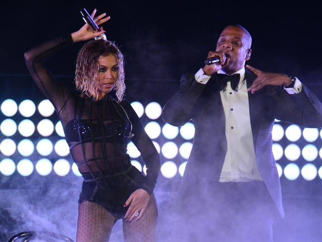 On the run ... Beyonce Knowles and Jay-Z perform on stage for the 56th Grammy Awards in January.