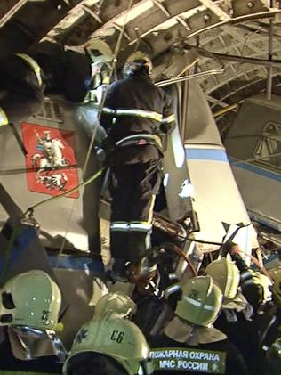 Rescue teams working inside the tunnel where several cars of the wrecked train look almost coiled. Picture: Russian Emergency Situation Ministry