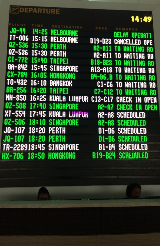 The departure board at Bali's Denpasar Airport showing flight cancellations. Picture by Raiza Andini