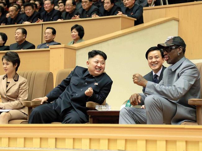 Kim Jong-un (C), his wife Ri Sol-Ju (L) and Dennis Rodman (R) watching a basketball game. Picture: AFP.