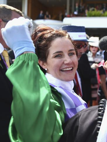 Michelle Payne celebrates after riding Prince of Penzance to win the Melbourne Cup.