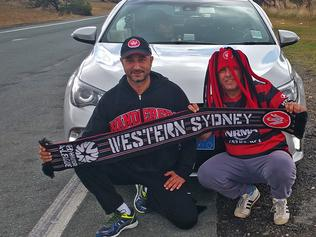 Western Sydney Wanderers fan - Sam Sabsabi with his friend Okan Vasacik just out of Hay NSW on his way to Adelaide for the Adelaide United v Western Sydney Match.