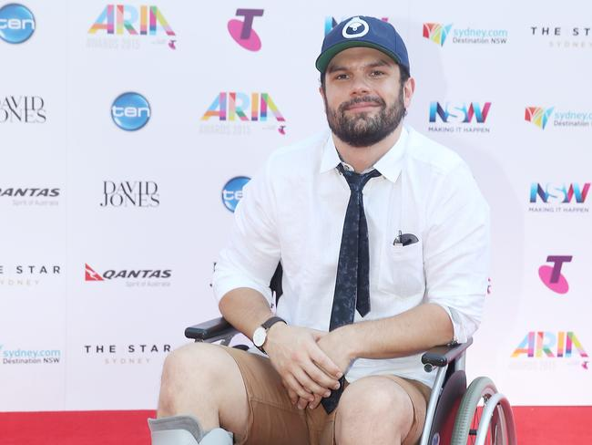 Unusual red carpet look ... Seth Sentry, in a wheelchair with a broken foot. Picture: Dylan Robinson