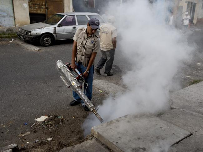 A health ministry worker fumigates for Aedes aegypti mosquitoes in Guatemala City. Picture: AP