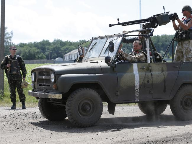 Check point ... Ukrainian army soldiers move to a position near the village of Dovgenke, Donetsk region, eastern Ukraine.