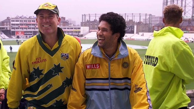 Shane Warne & Sachin Tendulkar head indoors out of rain at The Oval ground in London as practice session was called off at the 1999 World Cup. Picture: David White