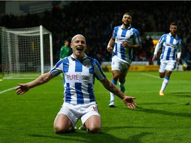 Aaron Mooy scores for Huddersfield.