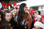 Jessica Mauboy at Central Station performing for the Indian Pacific Outback Christmas train which raises funds for the Royal Flying Doctors Service. Jessica Mauboy centre with children from Ashbury Public School. Picture: Nic Gibson