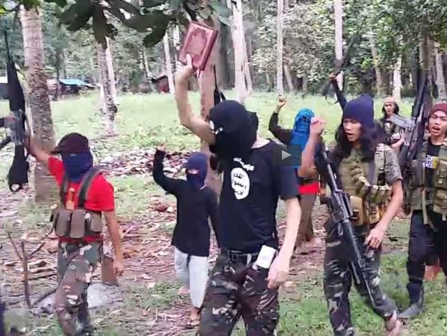 IS supporters march and chant in Mindanao, the southern Philippines. Picture: Supplied