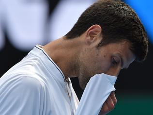 TOPSHOT - Serbia's Novak Djokovic reacts after a point against Uzbekistan's Denis Istomin during their men's singles match on day four of the Australian Open tennis tournament in Melbourne on January 19, 2017. / AFP PHOTO / PAUL CROCK / IMAGE RESTRICTED TO EDITORIAL USE - STRICTLY NO COMMERCIAL USE